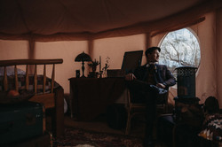 Groom in wedding yurt