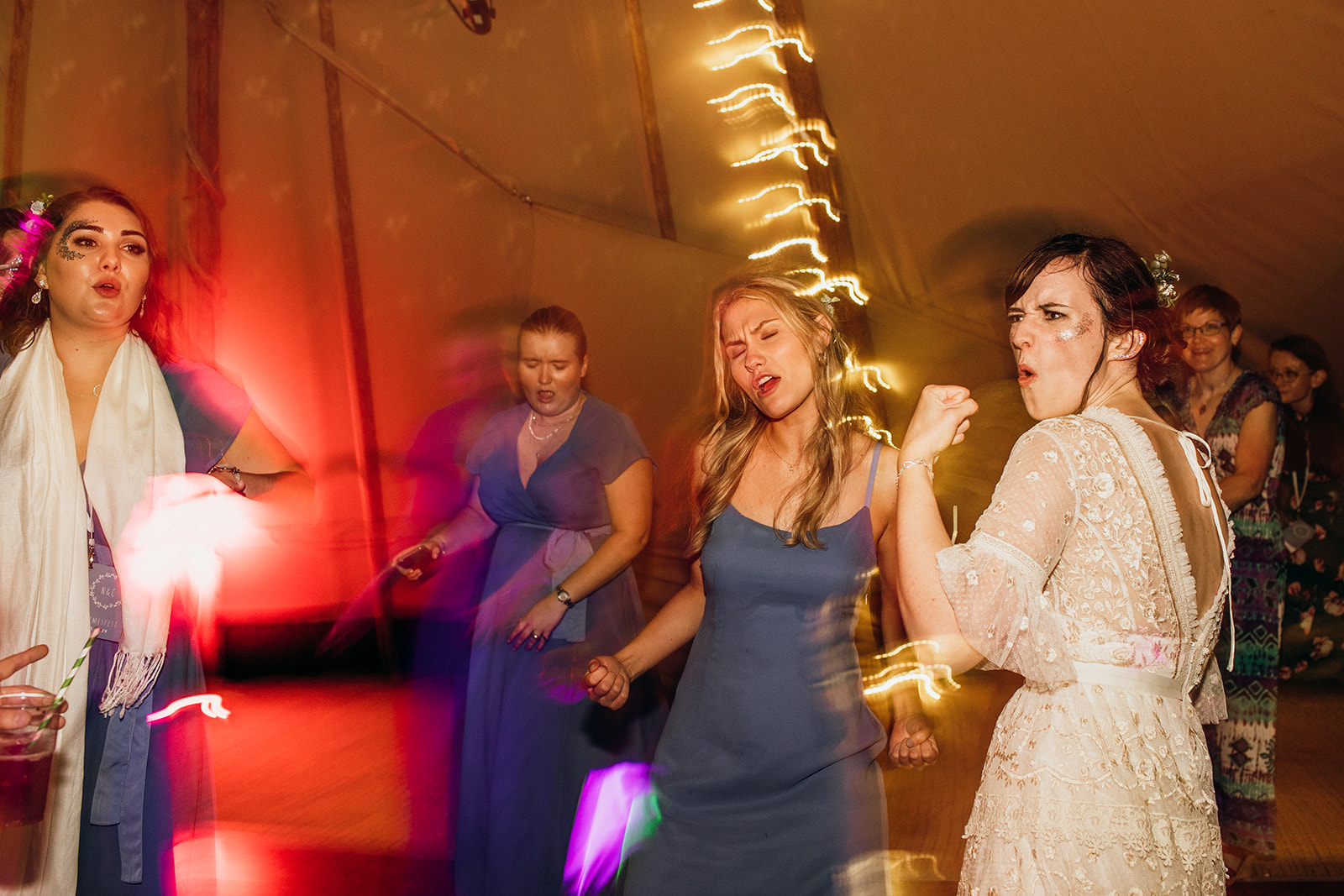 Bride and Bridesmaids dancing