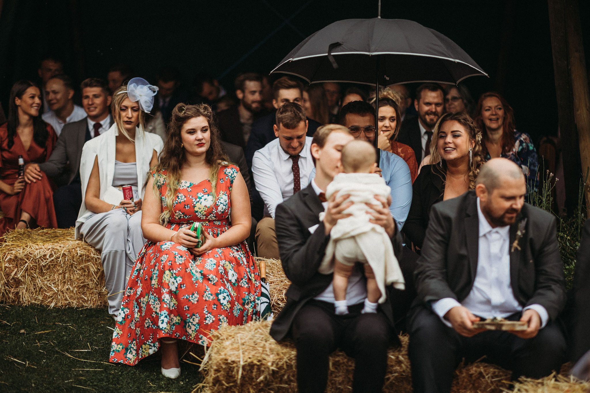 Wedding guests on hay bales