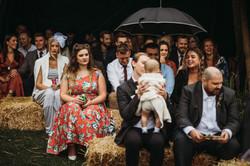 Wedding guests on hay bales