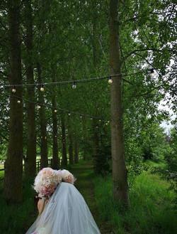 Bride to be under festoon lighting