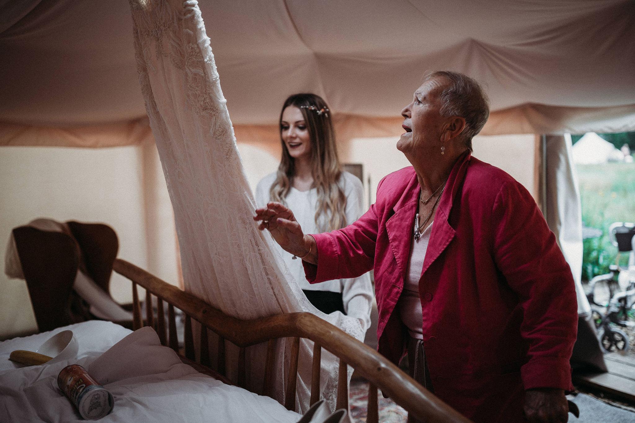 Admiring the wedding dress