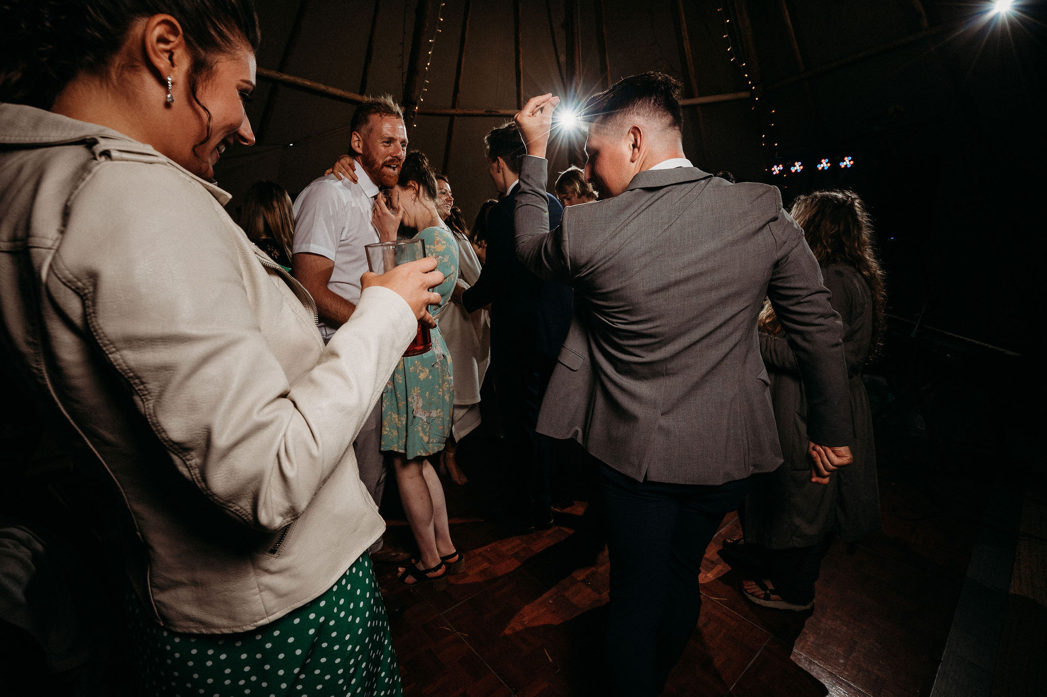 Wedding guests dancing in tipi