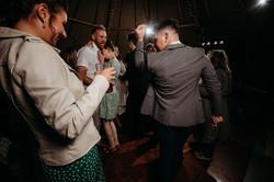 Wedding guests dancing in tipi