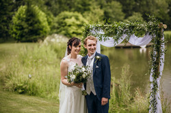 Bride and Groom by lakeside