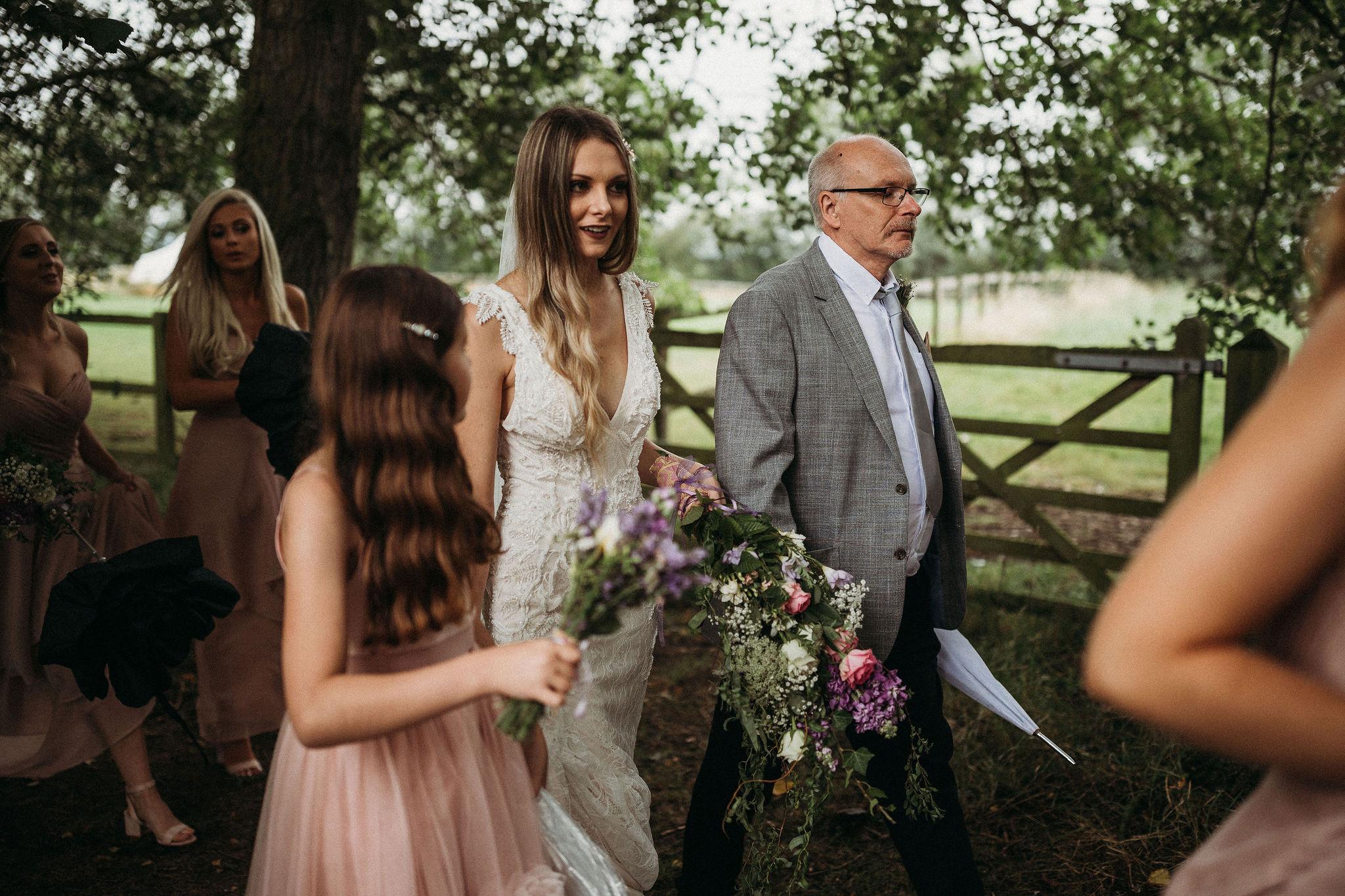 Bride walking to lakeside ceremony
