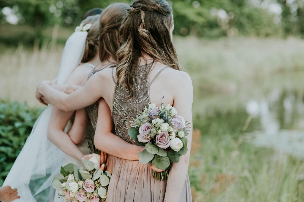 Bride and Bridesmaids by lake