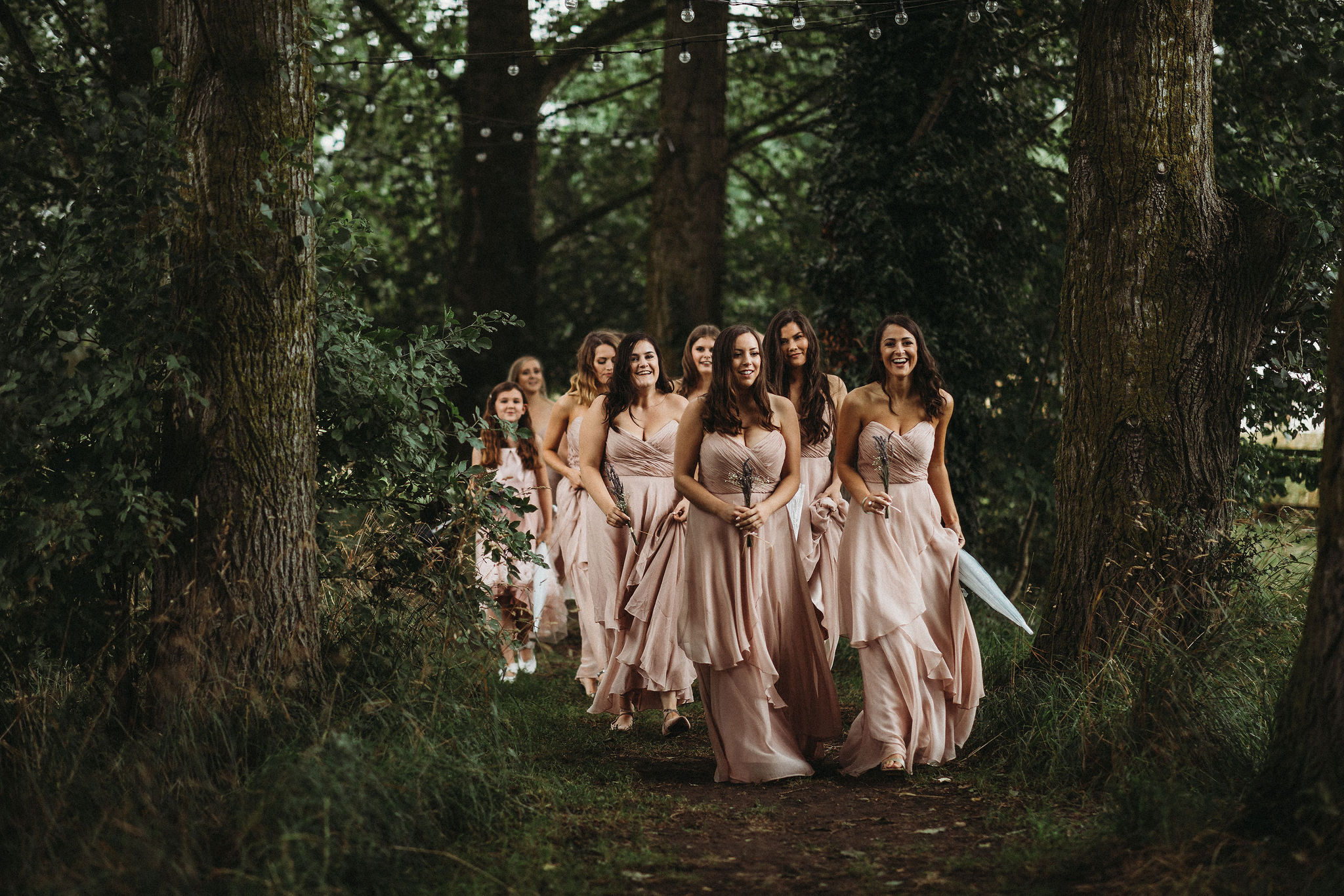 Bridesmaids under festoon walkway