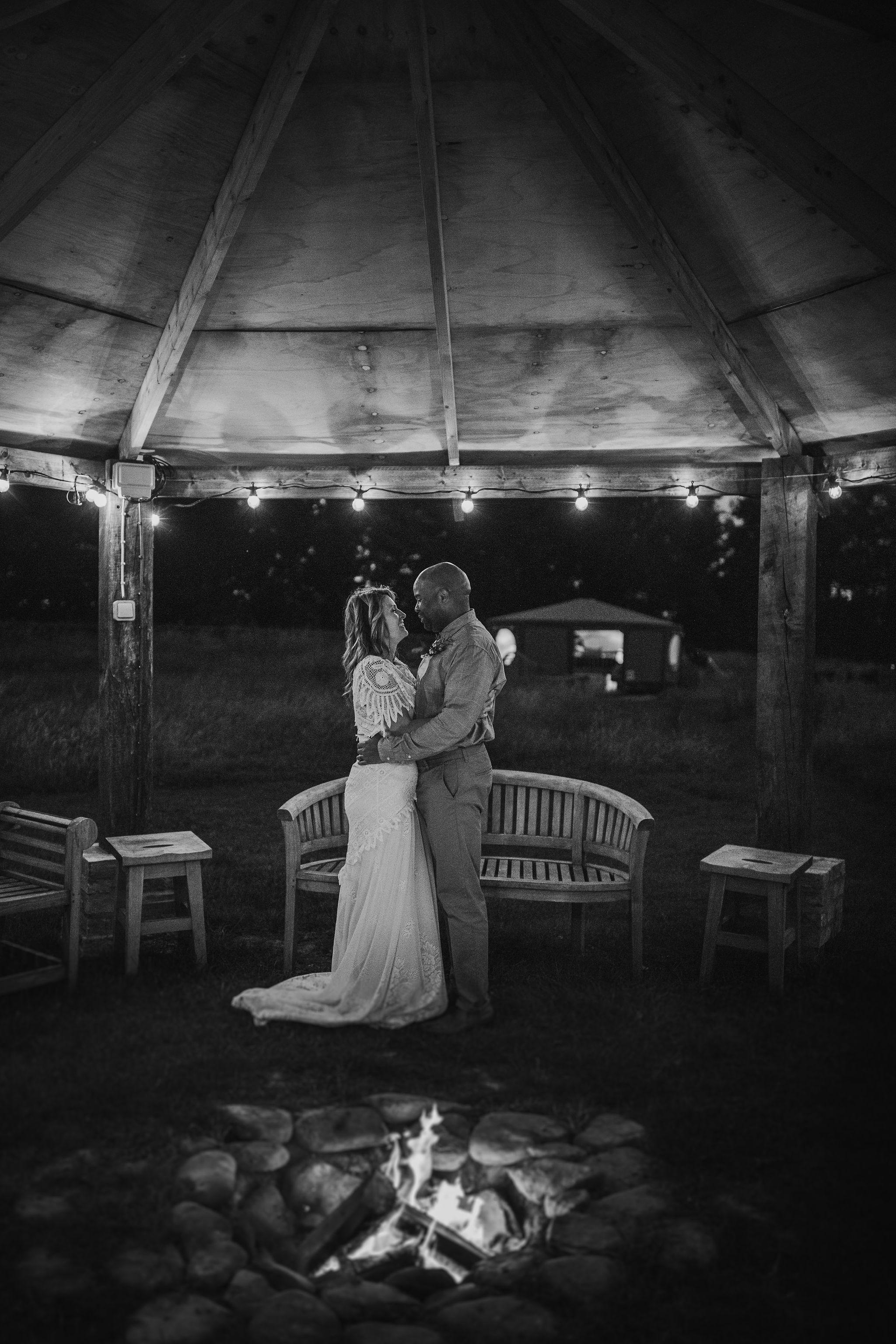 Couple under Festoon lit Pergola