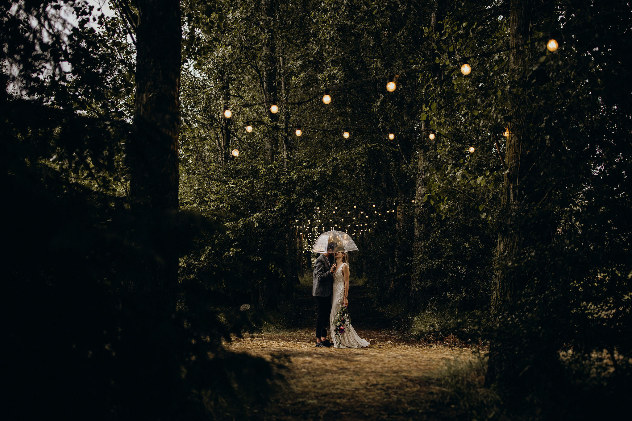 Bride and Groom under festoon lights
