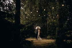 Bride and Groom under festoon lights