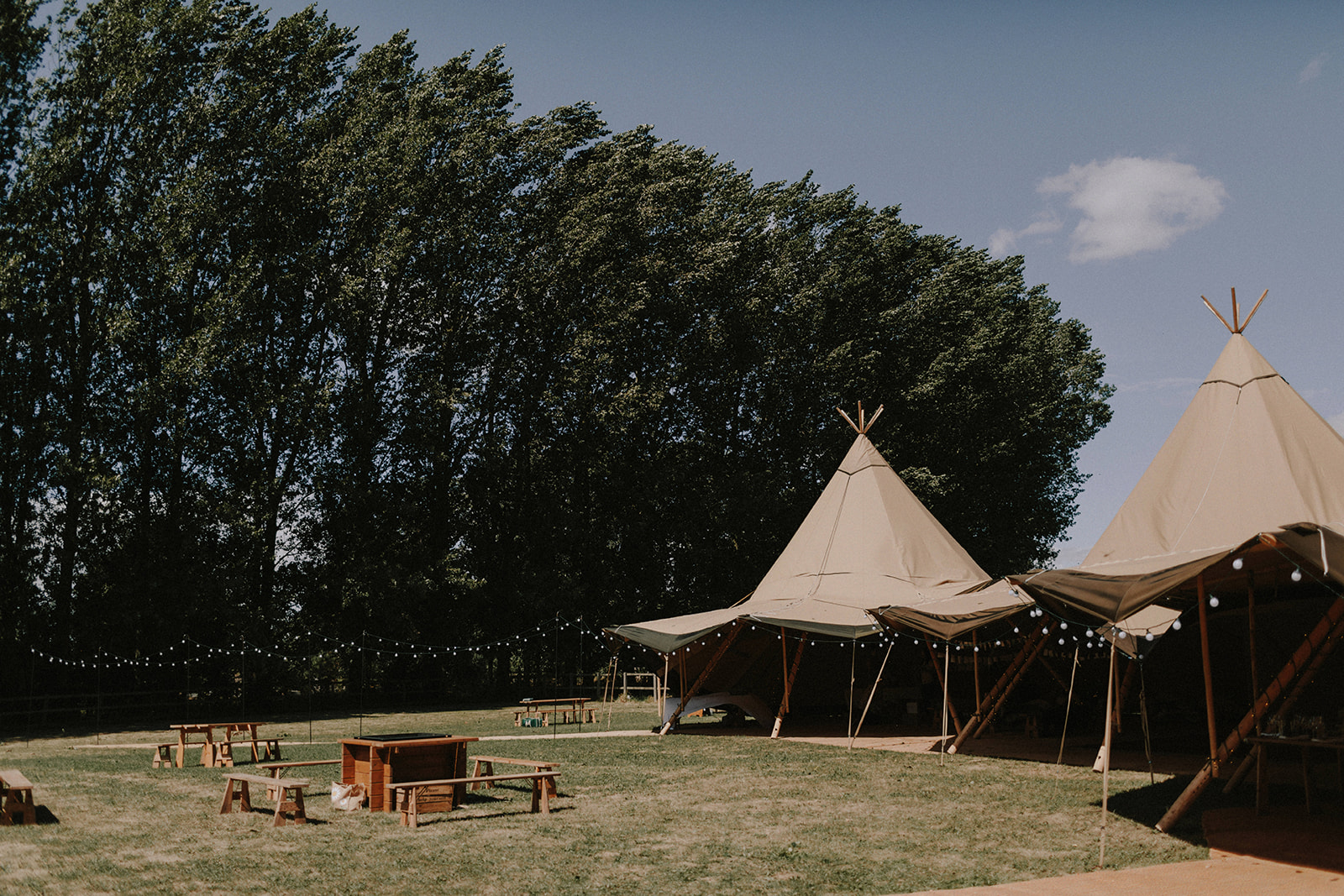 Outdoor wedding with tipi