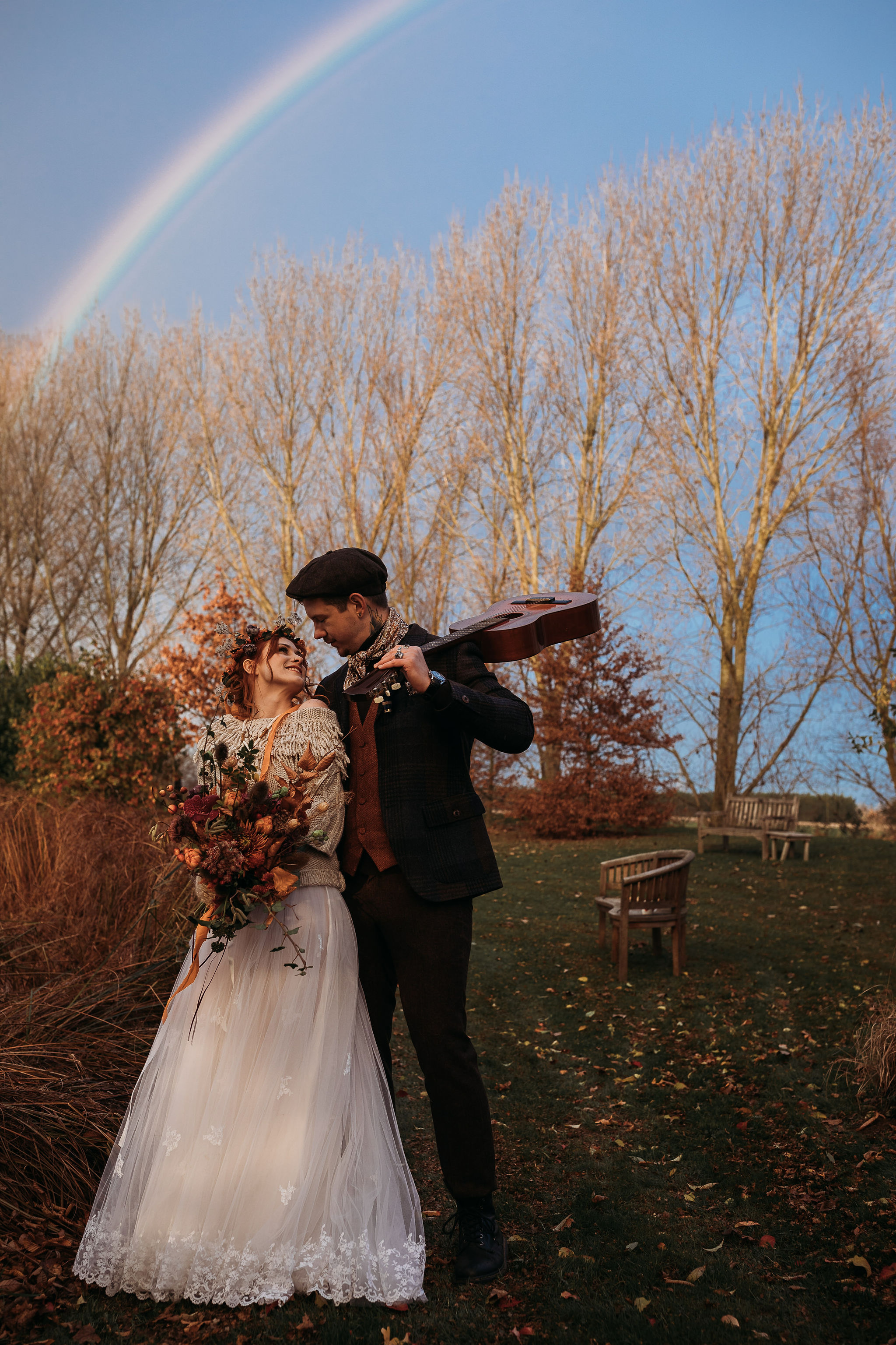 Bride and Groom under rainbow