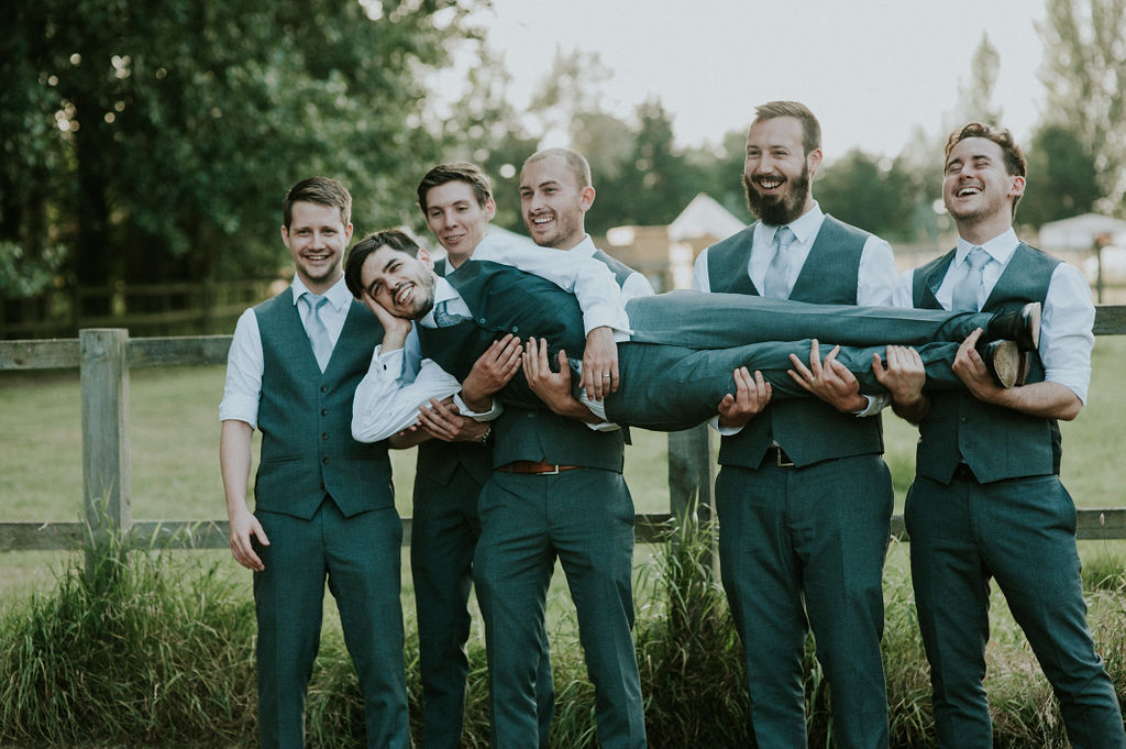 Groom being lifted