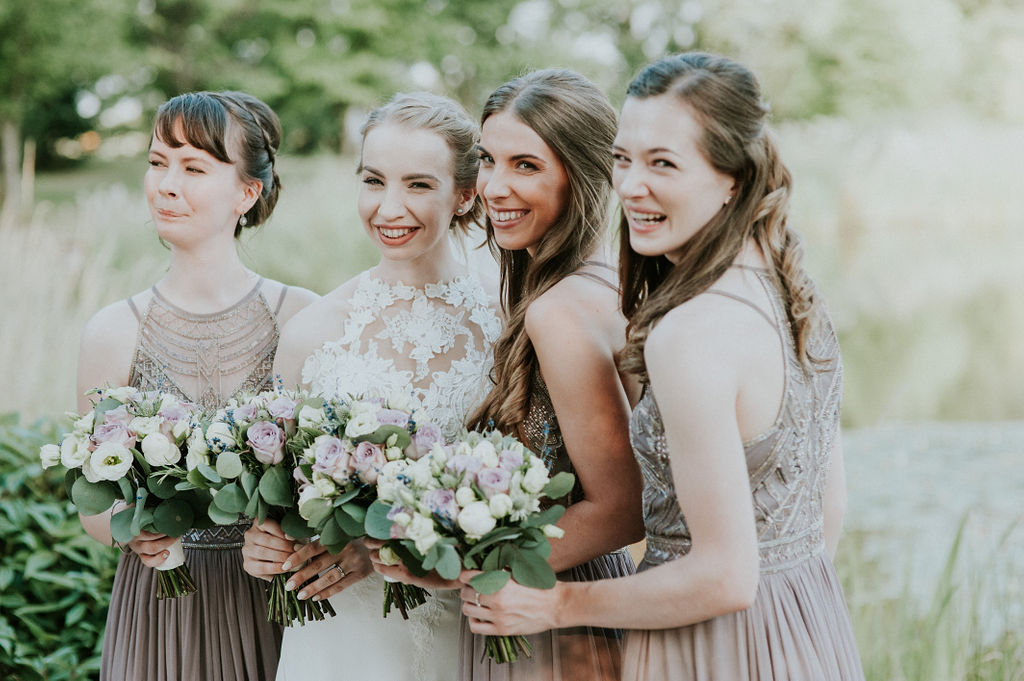 Bride and Bridesmaids by lake