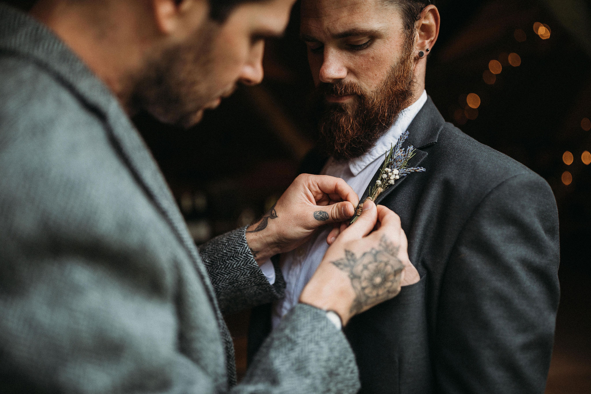 Groom doing buttonhole