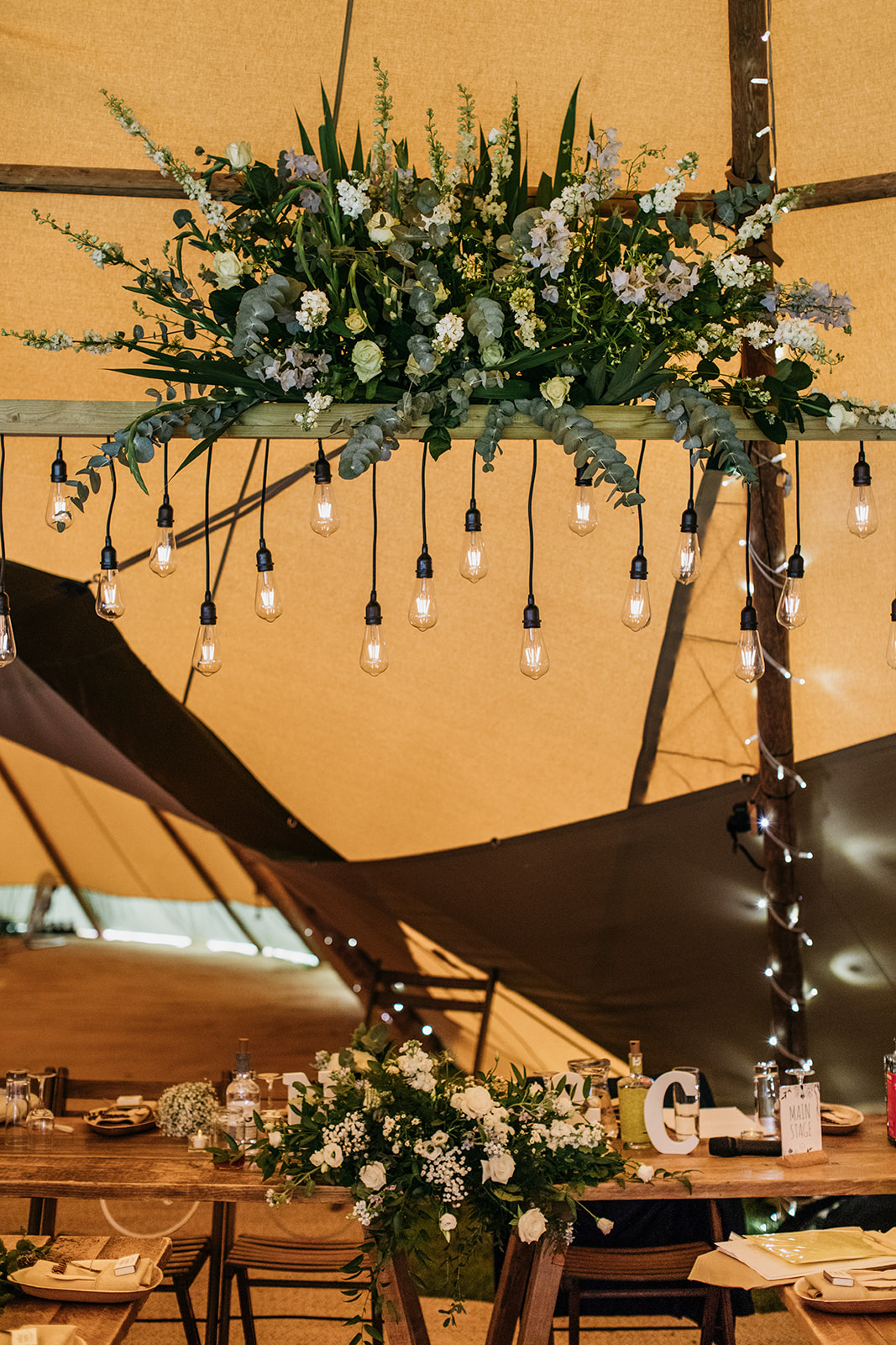 Wedding flowers in tipi