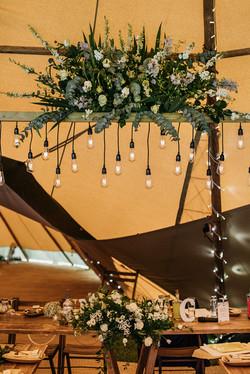 Wedding flowers in tipi