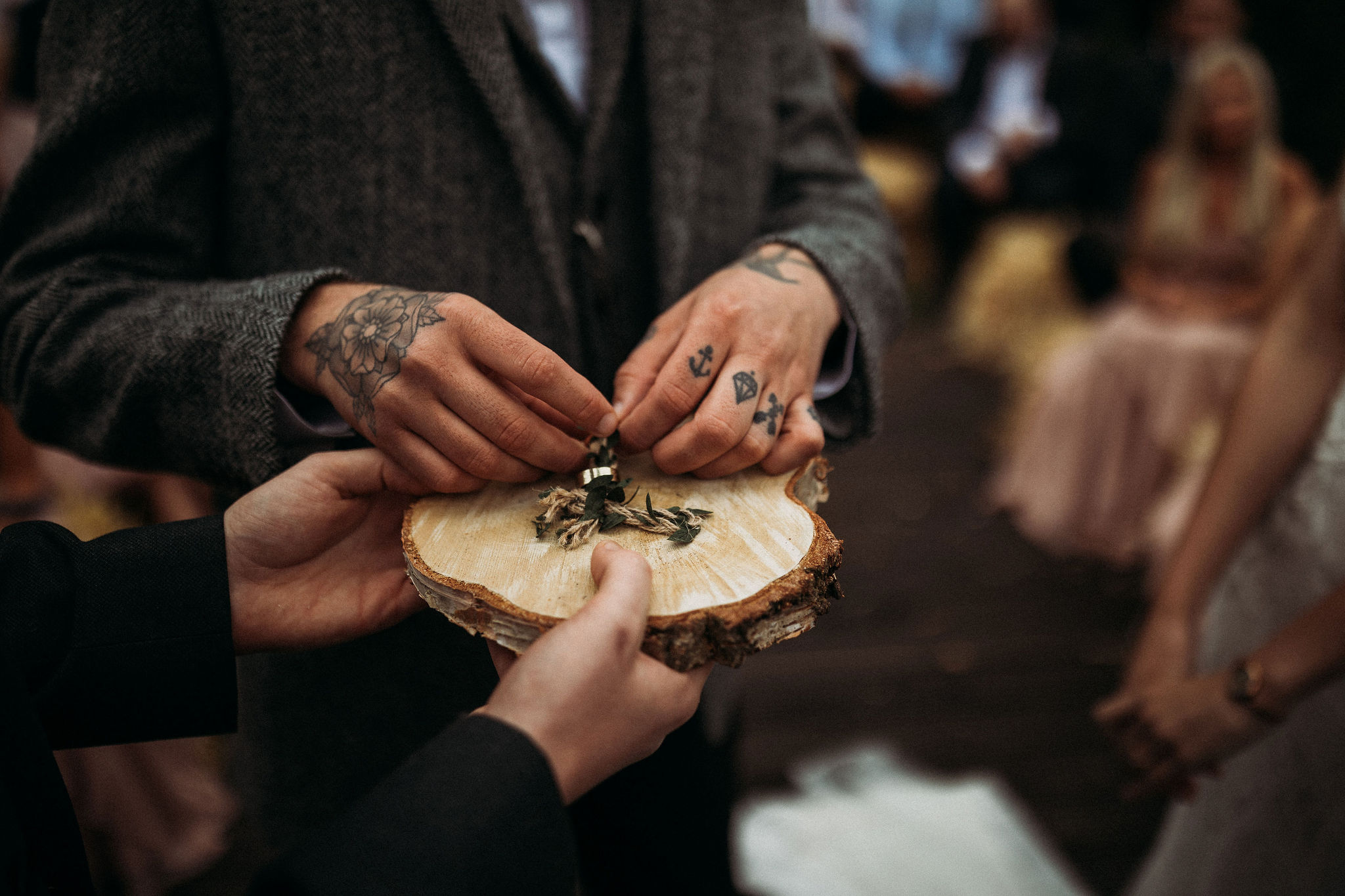 Wedding rings on log slice