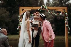 Bride and Groom under wedding arch