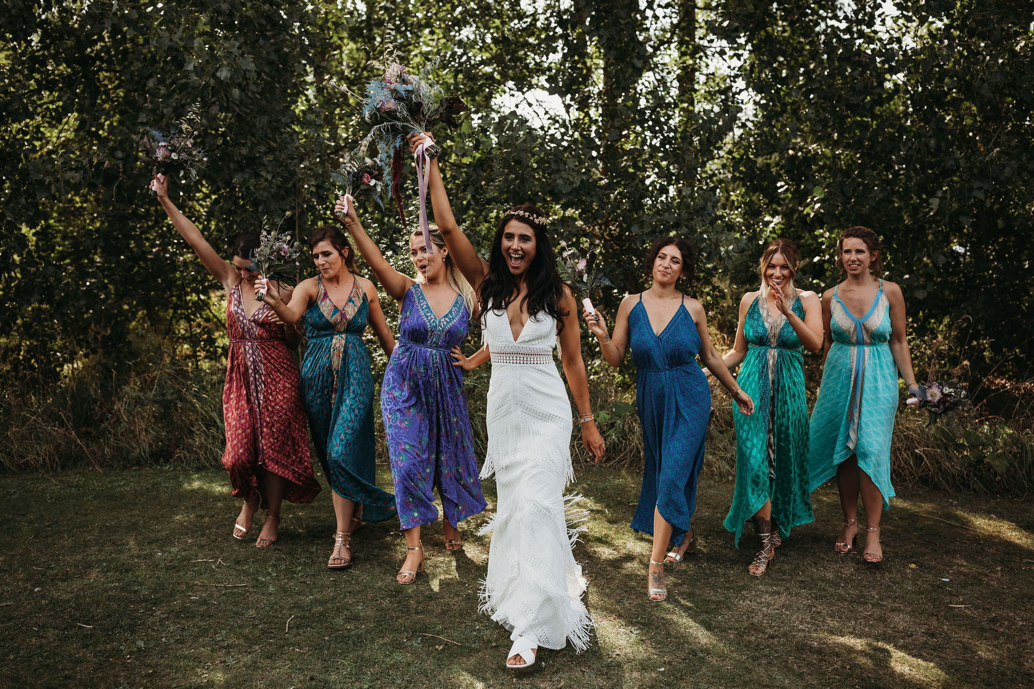 Bride celebrating with bridesmaids