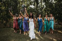 Bride celebrating with bridesmaids