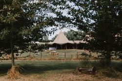 Outdoor wedding venue with tipi