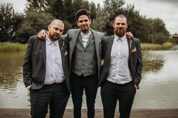 Groom with friends by the lake