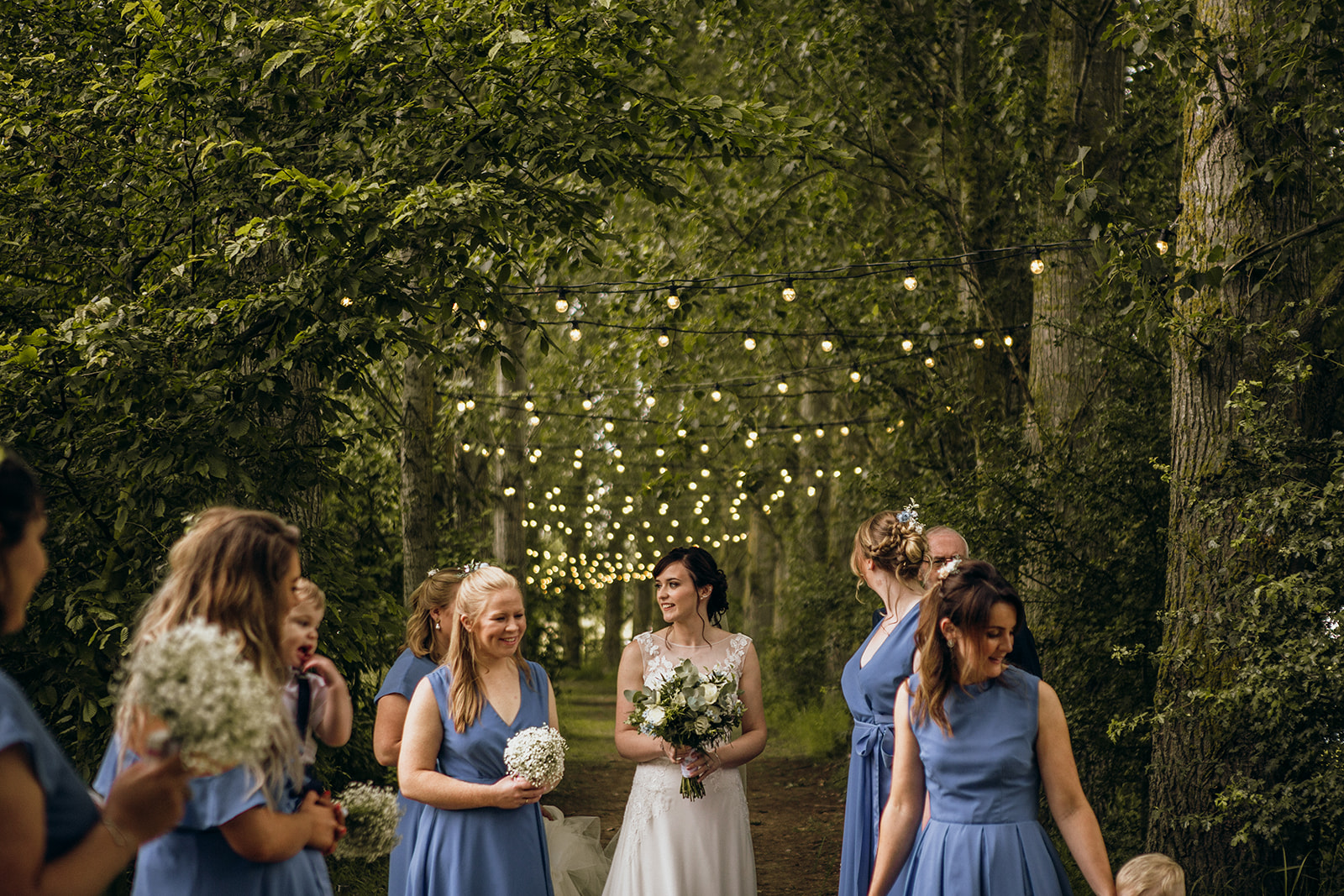 Bride and bridesmaids under walkway