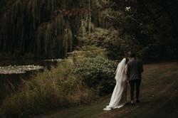 Bride and Groom walking by lake