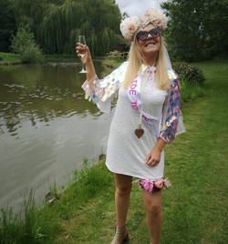Bride to be celebrating by lake