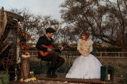Groom playing guitar to Bride