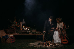 Bride and Groom by campfire