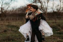 Bride having a piggyback