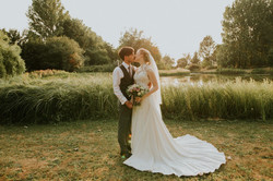 Bride and Groom by lake