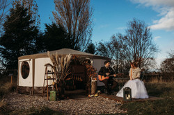 Bride and Groom outside yurt