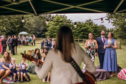 Wedding guests listening to music