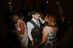 Groom dancing with guest