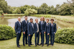 Groom with friends by lake