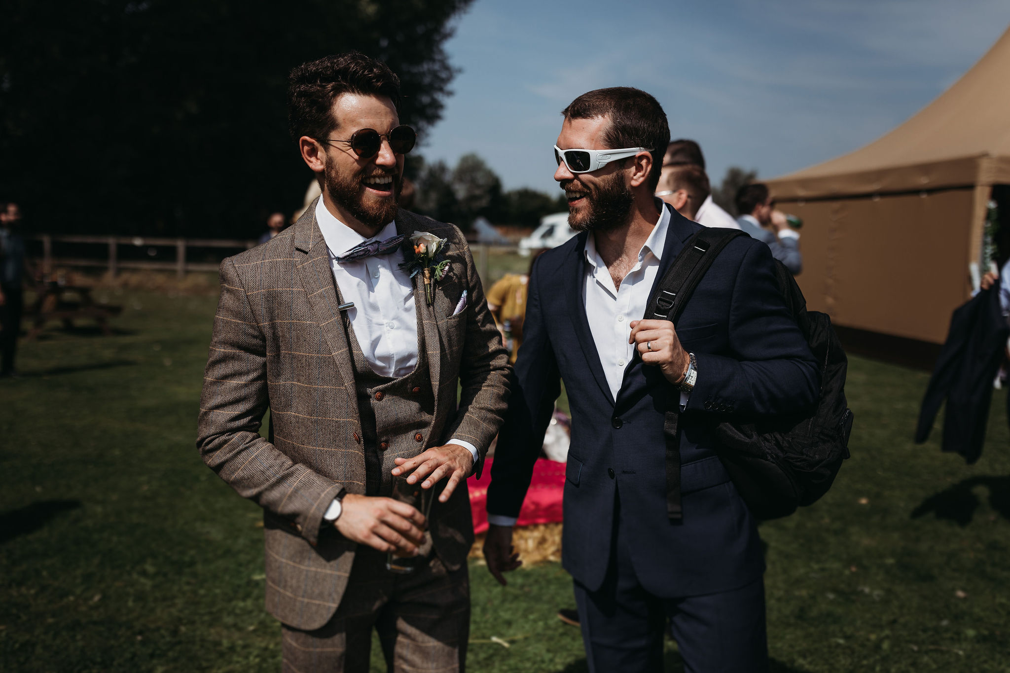 Groom and guest enjoying the day