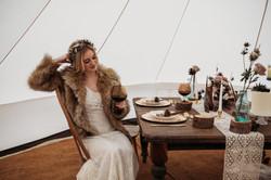 Bride In wedding bell tent