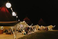 Nighttime wedding tipi