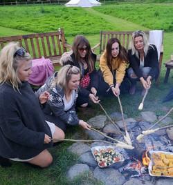 Hen do around campfire