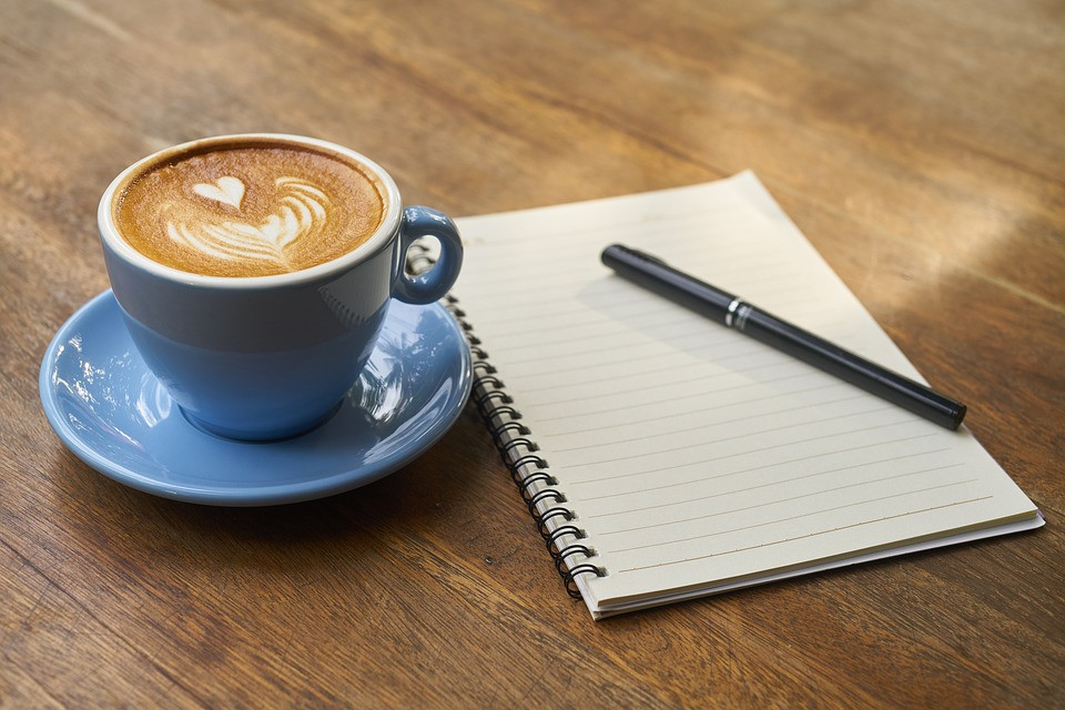 Just some generic coffee next to a notepad