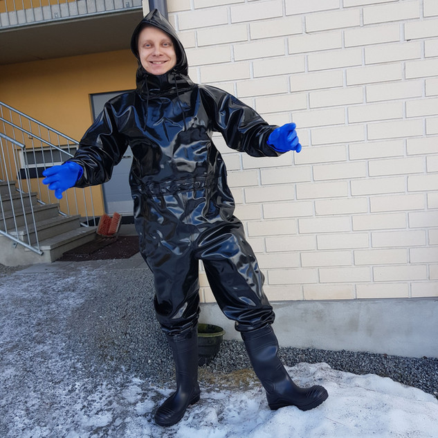 Black Extreme Drainage coverall with blue gloves