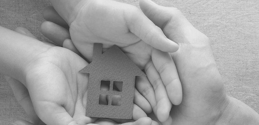 hands holding house.jpg
