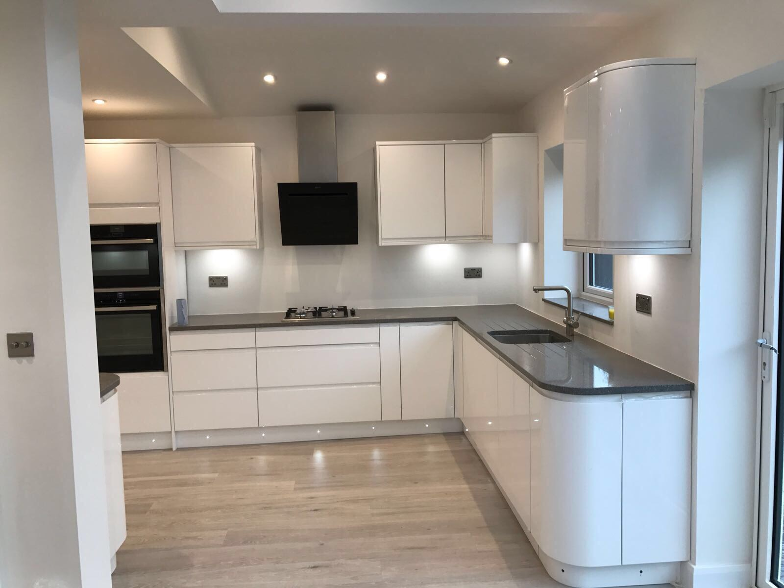 White kitchen with LED