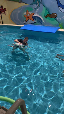 Teaching 1 year olds forward propulsion while submerged
