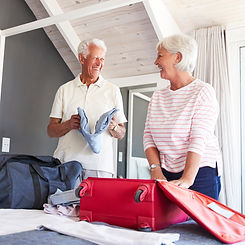 Traveling Old Couple Packing-cropped.jpg