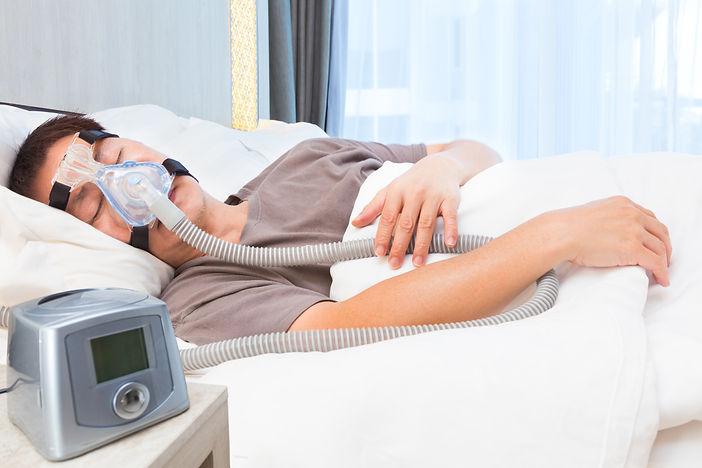 Man sleeping with CPAP 8_18.jpg